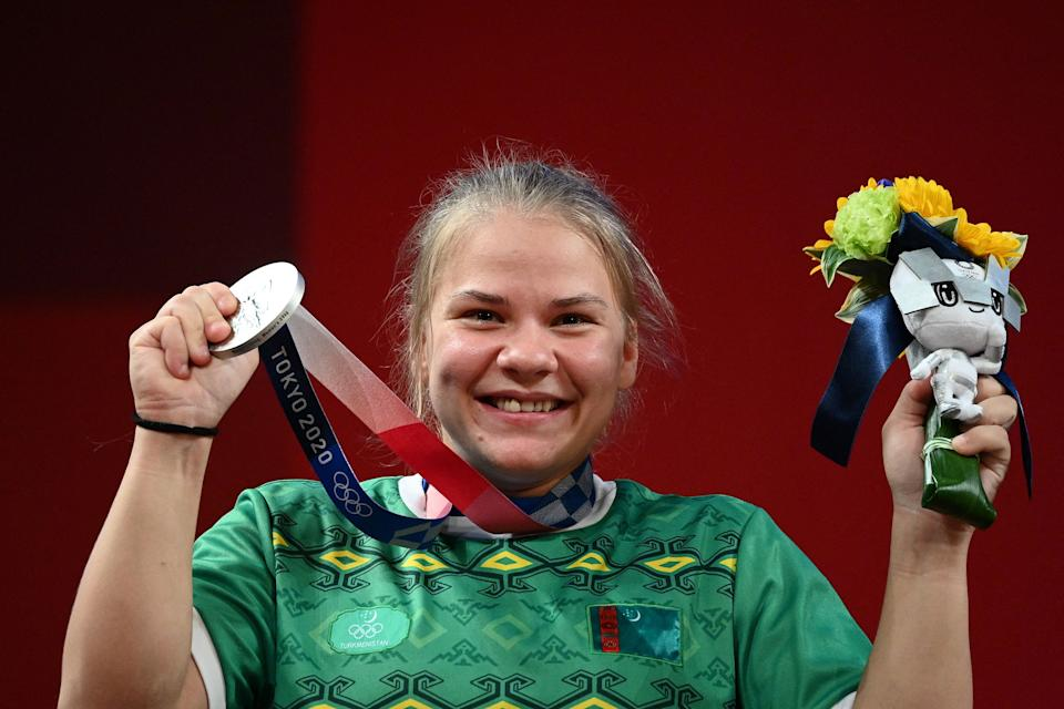 Silver medallist Turkmenistan's Polina Guryeva stands on the podium for the victory ceremony.