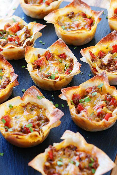 "<p>No food waste here. Use leftover dumpling wrappers to make these two-bite taco cups.</p><p><em><a href=""http://www.kevinandamanda.com/crunchy-taco-cups/"" rel=""nofollow noopener"" target=""_blank"" data-ylk=""slk:Get the recipe from Kevin and Amanda »"" class=""link rapid-noclick-resp"">Get the recipe from Kevin and Amanda »</a></em><br></p>"