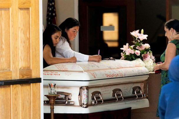 PHOTO: Mourners write on Keyla Salazar's casket during the 13-year-old's funeral on Tuesday, Aug. 6, 2019, in San Jose, Calif. (Noah Berger/AP)