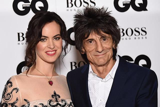 Rolling Stones guitarist Ronnie Wood — here with his wife, Sally Humphreys — opted not to have chemo because of its side effect: hair loss. (Photo: Getty Images)