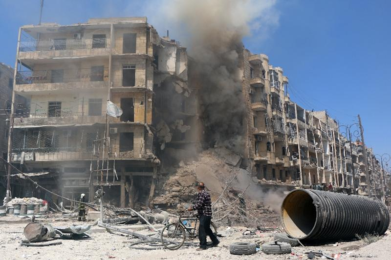 A man walks past the rubble of a building following reported shelling by Syrian government forces in the Bab al-Hadid neighbourhood of the northern city of Aleppo on April 18, 2015