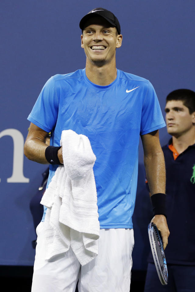 Tomas Berdych, of Czech Republic, laughs after Roger Federer, of Switzerland, hit a passing shot during a quarterfinals match at the U.S. Open tennis tournament, Wednesday, Sept. 5, 2012, in New York. (AP Photo/Darron Cummings)