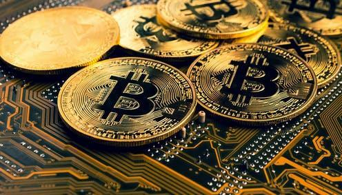 """<span class=""""caption"""">El Salvador is likely to become the first country to adopt bitcoin as legal tender. </span> <span class=""""attribution""""><a class=""""link rapid-noclick-resp"""" href=""""https://www.shutterstock.com/image-photo/golden-coins-bitcoin-symbol-on-mainboard-1698227716"""" rel=""""nofollow noopener"""" target=""""_blank"""" data-ylk=""""slk:Momentum Fotograh/Shutterstock"""">Momentum Fotograh/Shutterstock</a></span>"""