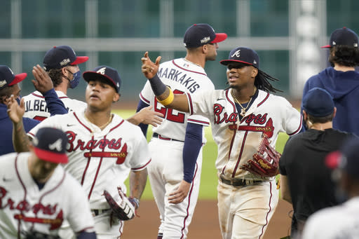 Acuña HR, plunked again, Braves top Marlins 9-5 to open NLDS