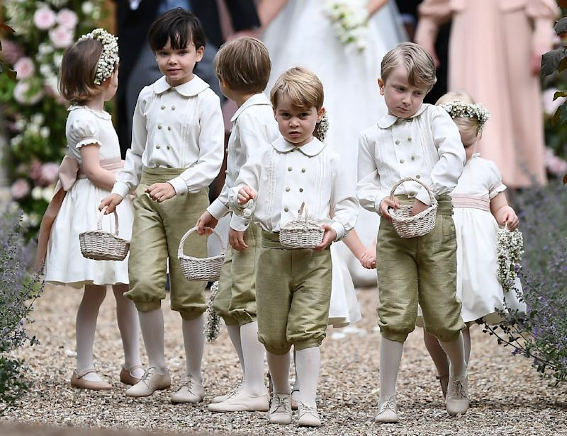 TOPSHOT - Britain's prince George (front row C), a pageboy, reacts following the wedding of his aunt Pippa Middleton to her new husband James Matthews, at St Mark's Church in Englefield, west of London, on May 20, 2017.After turning heads at her sister Kate's wedding to Prince William, Pippa Middleton graduated from bridesmaid to bride on Saturday at a star-studded wedding in an English country church. The 33-year-old married financier James Matthews, 41, at a ceremony attended by the royal couple and tennis star Roger Federer, wearing a couture dress by British designer Giles Deacon. / AFP PHOTO / POOL AND AFP PHOTO / Justin TALLIS (Photo credit should read JUSTIN TALLIS/AFP/Getty Images)