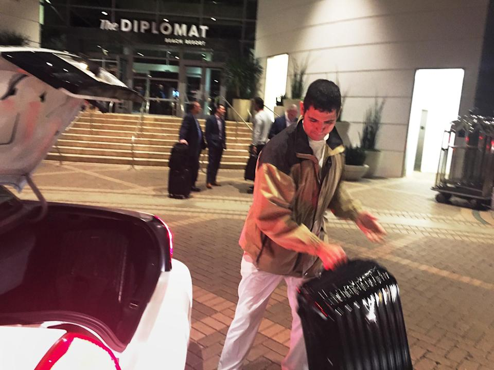 Julio Lopez handles a suitcase at the Diplomat Beach Resort in Hollywood, Florida, before COVID-19 forced it to close. The 16-year hotel veteran and his co-workers are demanding that they get their jobs back once the hotel reopens. (Photo: Courtesy Julio Lopez)