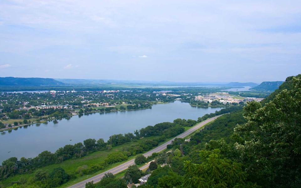 """<p>There is at least one festival every month in this Minnesota river town known for its striking bluffs and mountain views. For <a href=""""http://www.travelandleisure.com/slideshows/25-great-american-adventures"""" rel=""""nofollow noopener"""" target=""""_blank"""" data-ylk=""""slk:those who want adventure"""" class=""""link rapid-noclick-resp"""">those who want adventure</a>, Winona has snowshoeing and cross-country skiing in winter; hiking, kayaking, boating, biking, golfing, and fishing the rest of the year. If you're more of the dinner-and-a-show type, the town has museums, theaters, and a historic district. If you like both, plan for a longer trip.</p>"""