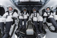In this Sunday, Sept. 12, 2021 photo made available by SpaceX, from left, Chris Sembroski, Sian Proctor, Jared Isaacman and Hayley Arceneaux sit in the Dragon capsule at Cape Canaveral in Florida, during a dress rehearsal for the upcoming launch. The fully automated Dragon is the same kind that SpaceX uses to send astronauts to and from the International Space Station for NASA. But the chartered flight won't be going there. (SpaceX via AP)