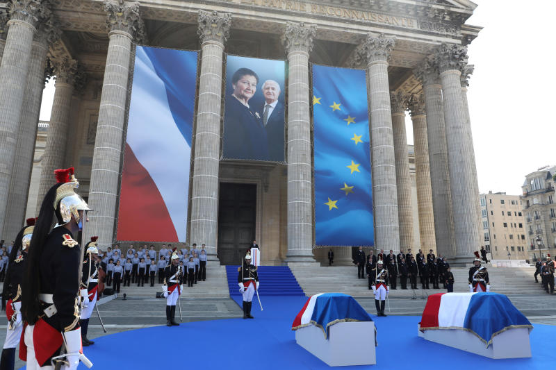French President Emmanuel Macron, rear, delivers a speech in tribute to late Holocaust survivor Simone Veil and her late husband Antoine Veil during a national tribute before being laid to rest in the crypt of the Pantheon mausoleum, in Paris, France, July 1, 2018. Simone Veil, who became one of France's most revered politicians, is getting the rare honor of being buried with her husband Antoine, who died in 2013, at the Pantheon, where French heroes are interred, one year after her death. (Ludovic Marin/Pool Photo via AP).
