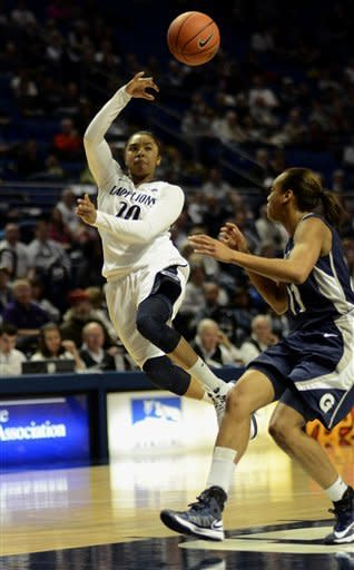 Penn State's Alex Bentley (20) passes across the paint past Georgetown's Andrea White (11) during the first half of an NCAA college basketball game in State College, Pa., Sunday, Dec. 9, 2012. (AP Photo/Ralph Wilson)