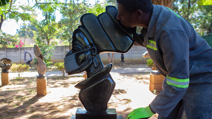 David Ngwerume with a face-masked sculpture in Harare, Zimbabwe - Friday 30 April 2021