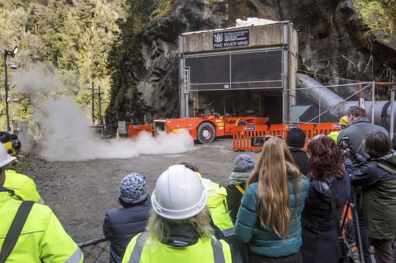 In this image released by the Pike River Recovery Agency, families watch as a loader enters the Pike River Mine, near Greymouth on the West Coast of New Zealand, Tuesday, May 21, 2019. Crews in New Zealand on Tuesday reentered an underground coal mine where a methane explosion killed 29 workers more than eight years ago, raising hopes among family members that they might find bodies and new evidence that leads to criminal charges. (Neil Silverwood/Pike River Recovery Agency via AP)