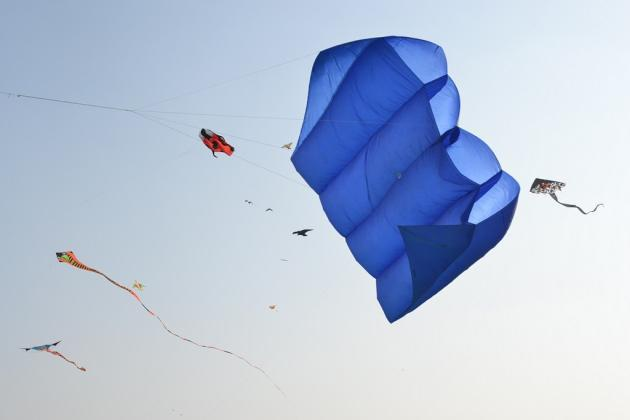 """Unusual kites from Malaysia and Indonesia join local Indian kites in a colorful pageant.  <br><br>Photo by Yahoo! reader <a target=""""_blank"""" href=""""http://www.flickr.com/photos/61545942@N08/"""">Nisarg Lakhmani</a>"""
