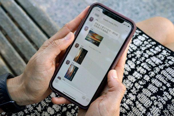 PHOTO: Sha Zhu shows the app WeChat on her phone, which she uses to keep in touch with family and friends in the U.S. and China, Aug. 18, 2020, in Washington, DC. (Jacquelyn Martin/AP)