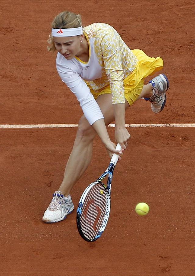 Russia's Ksenia Pervak returns the ball to compatriot Maria Sharapova during the first round match of the French Open tennis tournament at the Roland Garros stadium, in Paris, France, Monday, May 26, 2014. (AP Photo/Michel Euler)