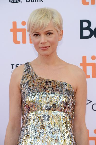<p>Michelle Williams was also another celeb to debut a pixie cut at the Toronto International Film Festival.<i> [Photo: Getty]</i></p>