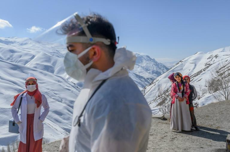 Saracoglu and his team had to spend an hour wheeling their all-terrain vehicle up dirt roads hugging snow-peaked mountains just to reach a man and two women on their list