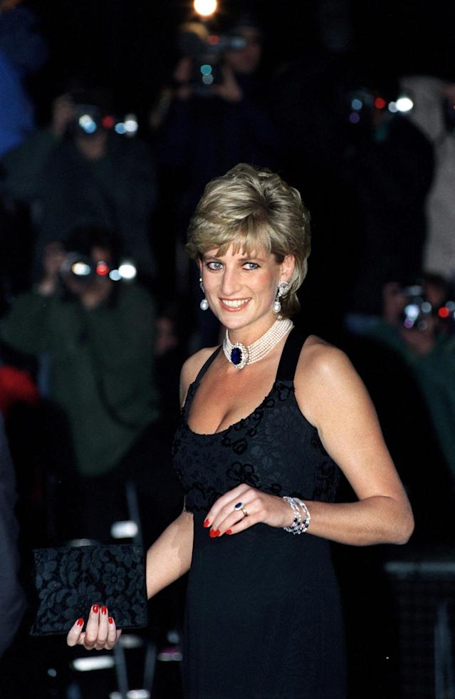 <p>Here, Diana, Princess Of Wales, combines several of her classic looks: pearls, a choker, and her signature red nails. Her LBD was designed by Jacques Azagury. (Photo: Tim Graham/Getty Images) </p>