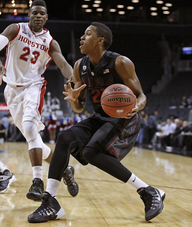 Houston guard Danuel House (23) defends as Stanford guard/forward Anthony Brown (21) tries to drive toward the basket in the first half of an NCAA college basketball game, part of the Legends Classic, Monday, Nov. 25, 2013, in New York. (AP Photo/Kathy Willens)