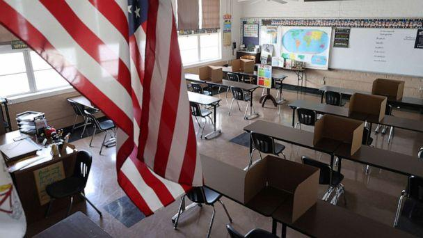 PHOTO: Social distancing dividers for students are seen in a classroom at St. Benedict School, amid the outbreak of COVID-19, in Montebello, near Los Angeles, July 14, 2020. (Lucy Nicholson/Reuters)