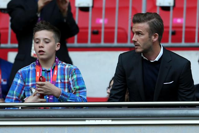 Footballer David Beckham (R) and his son Brooklyn watch the Men's Football first round Group A Match between Great Britain and United Arab Emirates on Day 2 of the London 2012 Olympic Games at Wembley Stadium on July 29, 2012 in London, England. (Photo by Julian Finney/Getty Images)