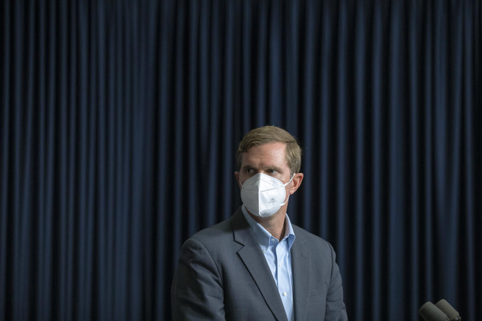 Kentucky Gov. Andy Beshear wears a mask while a video from a health care professional is played during a media briefing about the COVID-19 pandemic at the state Capitol in Frankfort, Ky., on Monday, Aug. 23, 2021. (Ryan C. Hermens/Lexington Herald-Leader via AP)