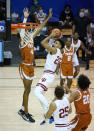Indiana forward Trayce Jackson-Davis (23) shoots in front of Texas forward Greg Brown (4) in the first half of a semifinal NCAA college basketball game in the Maui Invitational tournament, Tuesday, Dec. 1, 2020, in Asheville, N.C. (AP Photo/Kathy Kmonicek)