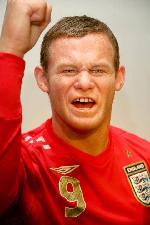 <p>Spray the Wayne Rooney at Madame Tussauds, London green and you can really see where that Shrek comparison came from. Copyright: [Getty] </p>