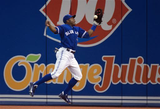 Toronto Blue Jays right fielder Rajai Davis misses a catch hit from Chicago White Sox's Paul Konerko during the fourth inning of a baseball game in Toronto on Wednesday April 17, 2013. (AP Photo/The Canadian Press, Nathan Denette)