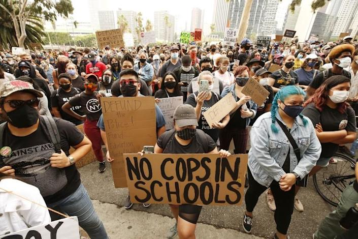 LOS ANGELES, CA - JUNE 16: Students and community members listen to speakers on the steps of LAUSD headquarters urging LAUSD to defund school police and eliminate their budget. Los Angeles on Tuesday, June 16, 2020 in Los Angeles, CA. (Al Seib / Los Angeles Times)