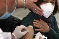 A woman receives the first dose of the Sinovac COVID-19 vaccine during a mass vaccination program at Skanderbeg Square in Tirana, Albania, Thursday, April 15, 2021. Albania has made virus slabs to almost 300,000 people, starting with the medical personnel, eldest people and schoolteachers to achieve a mass inoculation campaign ahead of the summer tourism season. (AP Photo)