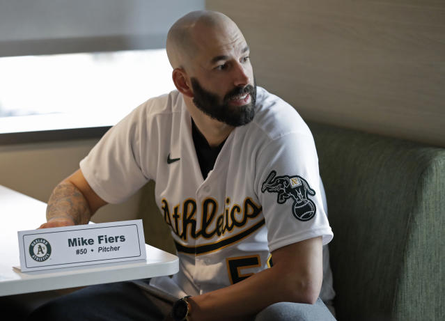 Oakland Athletics pitcher Mike Fiers waits to speak with the media on Friday, Jan. 24, 2020, in Oakland, Calif. Fiers, the Oakland pitcher and whistleblower in the Houston Astros sign-stealing scandal, appeared with teammates and manager Bob Melvin at team offices. Fiers has not spoken publicly about the sign stealing since the story was published in The Athletic in November. (AP Photo/Ben Margot)