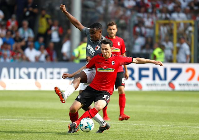Soccer Football - Bundesliga - SC Freiburg v FC Augsburg - Schwarzwald-Stadion, Freiburg, Germany - May 12, 2018 SC Freiburg's Nicolas Hofler in action with Augsburg's Sergio Cordova REUTERS/Kai Pfaffenbach DFL RULES TO LIMIT THE ONLINE USAGE DURING MATCH TIME TO 15 PICTURES PER GAME. IMAGE SEQUENCES TO SIMULATE VIDEO IS NOT ALLOWED AT ANY TIME. FOR FURTHER QUERIES PLEASE CONTACT DFL DIRECTLY AT + 49 69 650050