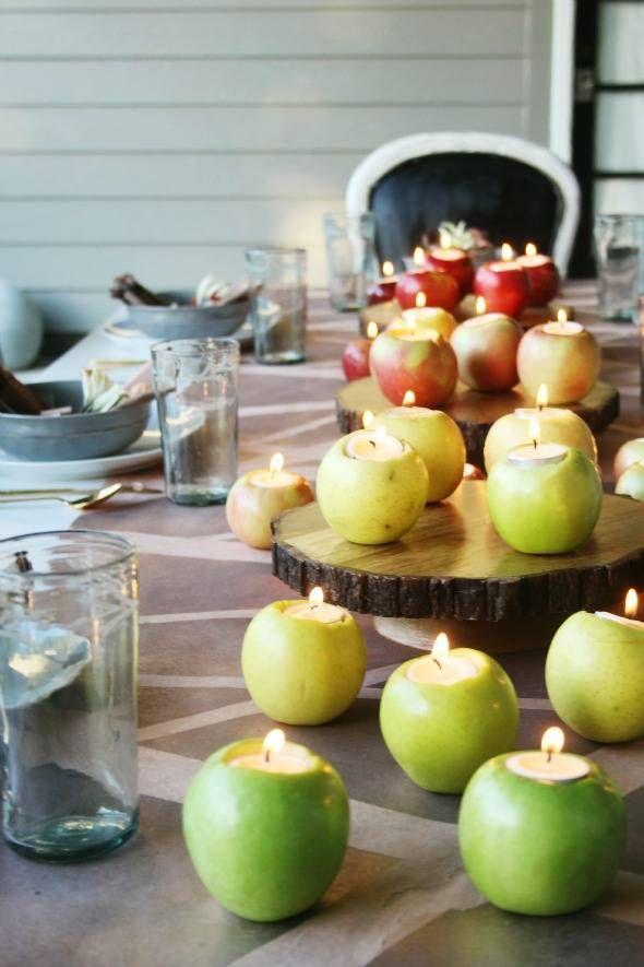 """<p>Hollowed-out apples become votives for thrifty hosts. Simply drop in affordable tea lights and you're done!</p><p><strong>Get the tutorial at <a href=""""http://littlegreennotebook.com/2015/10/fall-dinner-party.html/"""" rel=""""nofollow noopener"""" target=""""_blank"""" data-ylk=""""slk:Little Green Notebook"""" class=""""link rapid-noclick-resp"""">Little Green Notebook</a>.</strong></p><p><a class=""""link rapid-noclick-resp"""" href=""""https://www.amazon.com/s/ref=nb_sb_noss_2?url=search-alias%3Daps&field-keywords=wood+slab+cake+stand&tag=syn-yahoo-20&ascsubtag=%5Bartid%7C10050.g.2130%5Bsrc%7Cyahoo-us"""" rel=""""nofollow noopener"""" target=""""_blank"""" data-ylk=""""slk:SHOP WOODEN STANDS"""">SHOP WOODEN STANDS</a></p>"""