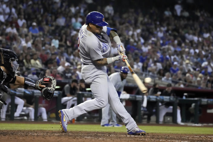 Chicago Cubs' Javier Baez hits an RBI-double against the Arizona Diamondbacks in the sixth inning during a baseball game, Saturday, July 17, 2021, in Phoenix. (AP Photo/Rick Scuteri)