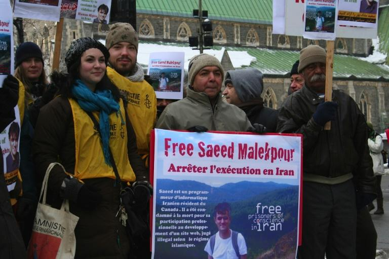 This January 22, 2012 photo shows supporters demonstrating for the release of Saeed Malekpour in Montreal, Canada