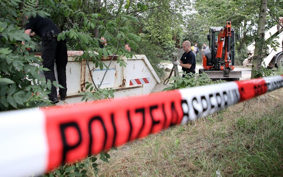 Police officers dig and search a garden plot in Hannover, northern Germany, 29 July 2020. Police is working on the site in relation to the investigation of the Madeleine 'Maddie' McCann case. The English child disappeared on 03 May 2007, from a room where she slept with two twin brothers, in an apartment of a resort in Praia da Luz in the Algarve. Police searches garden plot in the Maddie McCann case, Hanover, Germany - 29 Jul 2020 - FRIEDEMANN VOGEL/EPA-EFE/Shutterstock