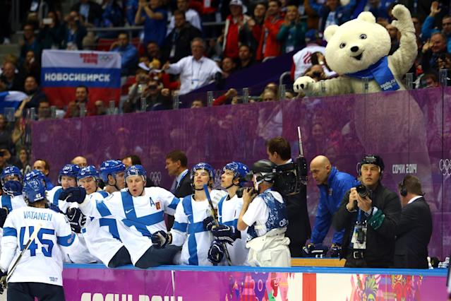SOCHI, RUSSIA - FEBRUARY 22: Sami Vatanen #45 of Finland celebrates a goal in the third period with teammates against the United States as the Polar Bear mascot looks on during the Men's Ice Hockey Bronze Medal Game on Day 15 of the 2014 Sochi Winter Olympics at Bolshoy Ice Dome on February 22, 2014 in Sochi, Russia. (Photo by Streeter Lecka/Getty Images)