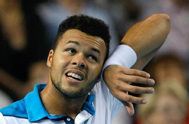France's Jo-Wilfried Tsonga wipes his face during the final match against Ernests Gulbis of Latvia, at the Open 13 tennis tournament, in Marseille, southern France, Sunday, Feb. 23 , 2014. (AP Photo/Claude Paris)