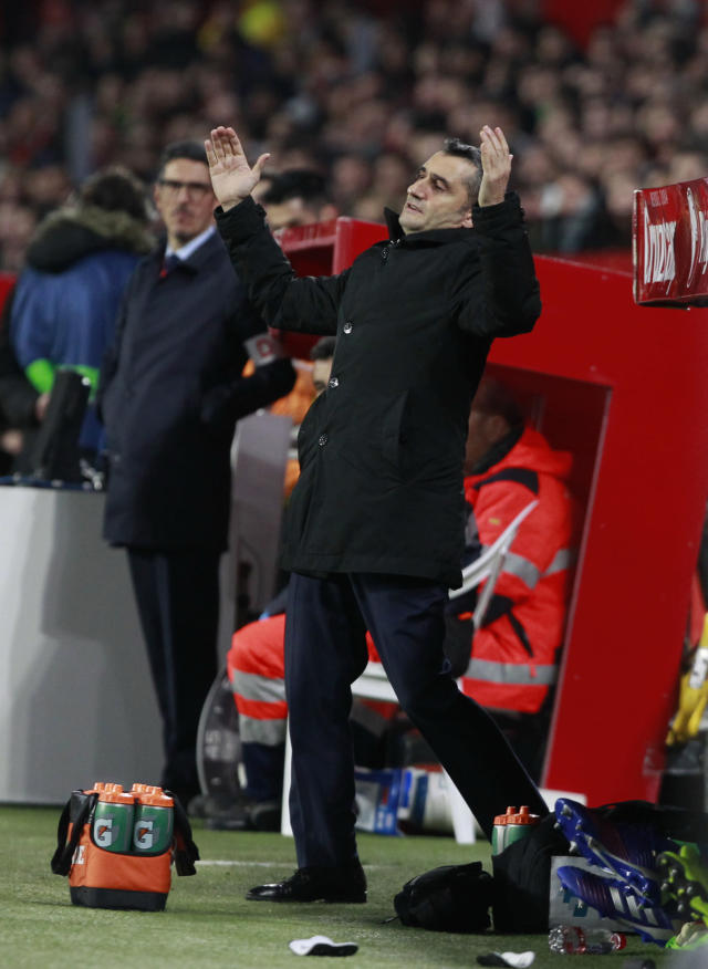 FC Barcelona's coach Ernesto Valverde gestures during a Spanish Copa del Rey soccer match between Sevilla and FC Barcelona in Seville, Spain, Wednesday Jan. 23, 2019. (AP Photo/Miguel Morenatti)