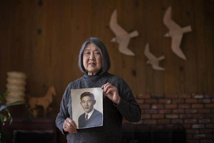 Los Angeles, CA - October 12: Joanne Kumamoto's father, Jiro Oishi, shown in photo, was one of the 120 Nisei students deprived of a degree as she is photographed with birds and a horse he made at her Mount Washington home. Jiro who was one of the 120 Nisei students deprived of a USC degree. In a policy reversal, USC will apologize to its former Japanese American students and offer them honorary degrees posthumously eight decades after impeding their efforts to complete their education after their forcible removal from the West Coast and incarceration during World War II. Joanne Kumamoto's father, Jiro Oishi, was one of the 120 Nisei students deprived of a degree. Photo taken at Joanne's Mount Washington home on Tuesday, Oct. 12, 2021. (Allen J. Schaben / Los Angeles Times)