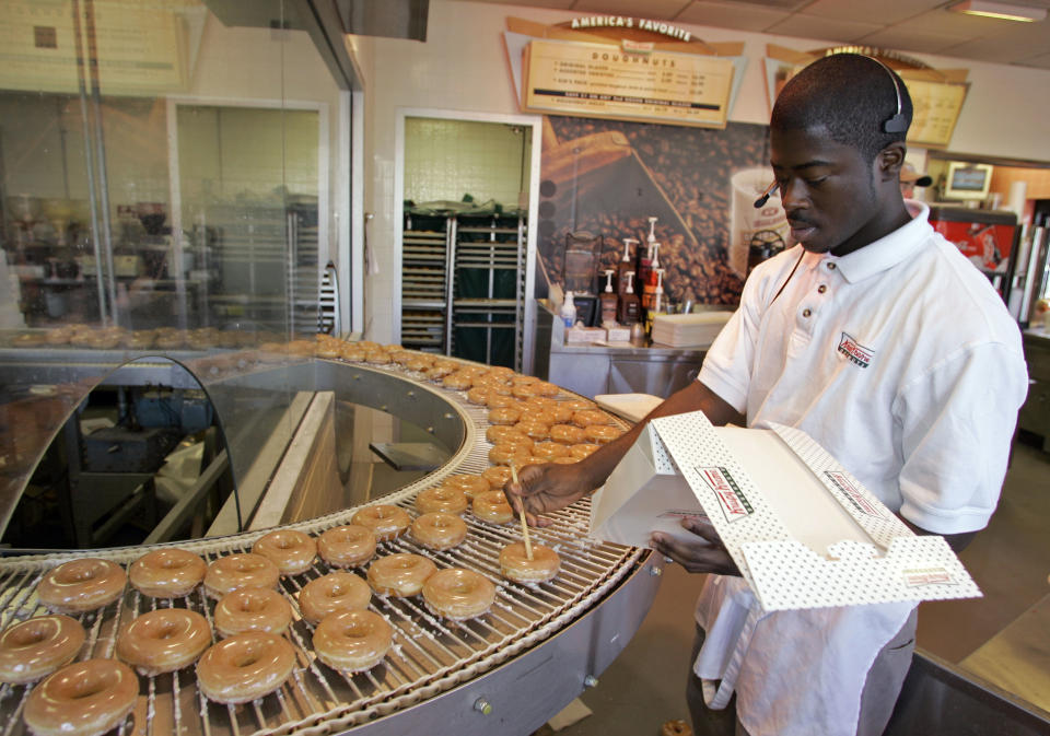 Jamalle Sanders packages glazed doughnuts at a Krispy Kreme store in Charlotte, N.C. The chain is offering free doughnuts to parents with babies born on Leap Day and the supporting hospital staff.