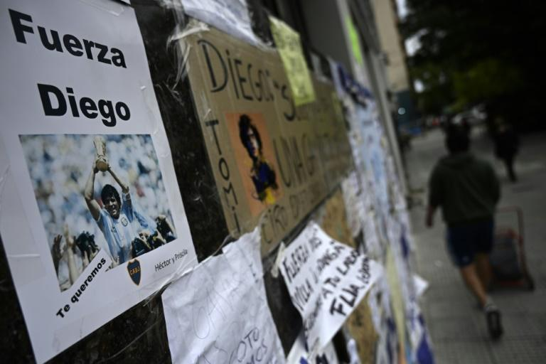 Messages of support are seen outside the private clinic where Argentine former football star and coach of Gimnasia y Esgrima La Plata Diego Maradona underwent a brain surgery for a blood clot, in Olivos, Buenos Aires Province, on November 9, 2020
