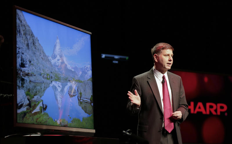 Sharp Electronics vice president for strategic product marketing Jim Sanduski, introduces Sharp's 4K Aquos Ultra HD flat screen tv during a news conference at the Consumer Electronics Show press day, Monday, Jan. 7, 2013, in Las Vegas. (AP Photo/Julie Jacobson)
