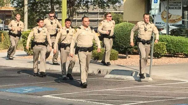 Police officers respond to a shooting at a Ross Dress for Less store in Las Vegas on Saturday, Aug. 11, 2018. (KTNV)
