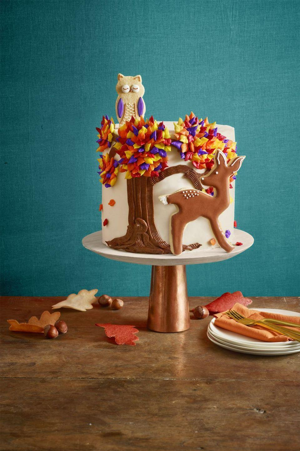"<p>Using a piping bag (and the easiest-ever buttercream frosting) to make fun fall decorations on this rich chocolate cake.</p><p><em><a href=""https://www.womansday.com/food-recipes/food-drinks/recipes/a60519/autumn-cake-recipe/"" rel=""nofollow noopener"" target=""_blank"" data-ylk=""slk:Get the recipe from Woman's Day »"" class=""link rapid-noclick-resp"">Get the recipe from Woman's Day »</a></em></p>"