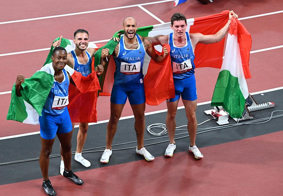 TOKYO, JAPAN - AUGUST 05: Lorenzo Patta, Lamont Marcell Jacobs, Eseosa Desalu, and Filippo Tortu of team Italy celebrate after winning gold in the Men's 4 x 100m Relay Final during the Tokyo 2020 Olympic Games at Olympic Stadium in Tokyo, Japan on August 06, 2021. (Photo by Mustafa Yalcin/Anadolu Agency via Getty Images)
