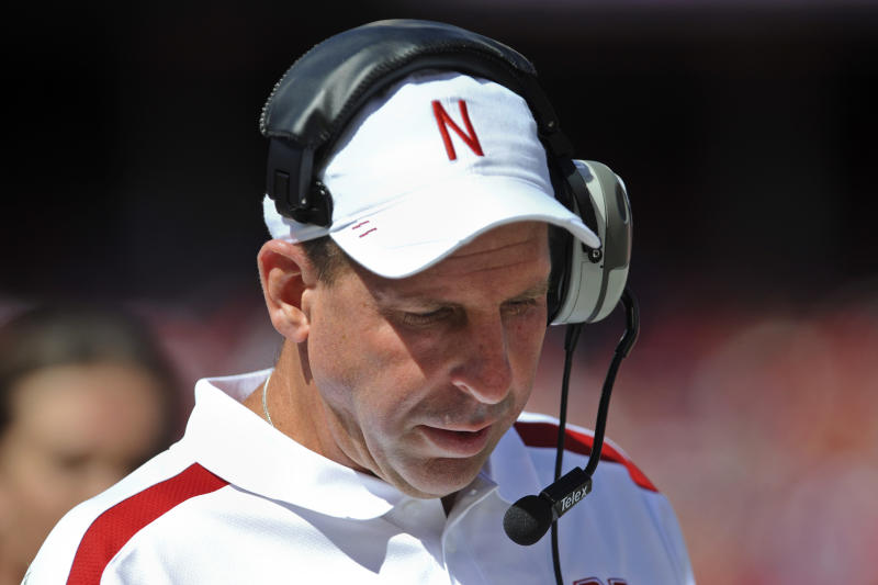 Nebraska head coach Bo Pelini looks down in the first half of an NCAA college football game against Arkansas State in Lincoln, Neb., Saturday, Sept. 15, 2012. Pelini left the game by ambulance after falling ill on the sideline in the first half. (AP Photo/Dave Weaver)
