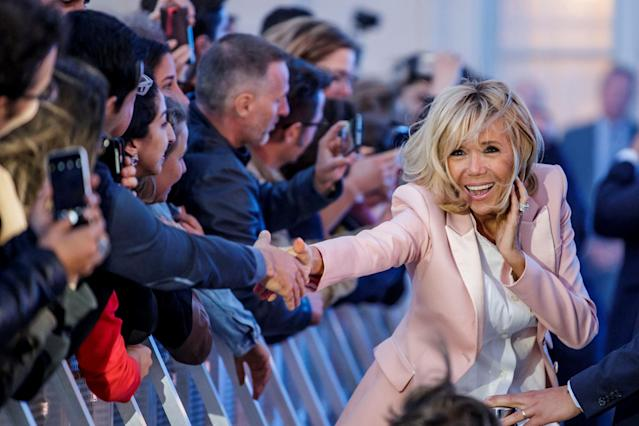 Brigitte Macron, the wife of the French president, greets people during the 'Fete de la Musique', the music day celebration in the courtyard of the Elysee Palace, in Paris, France, June 21, 2018. Christophe Petit Tesson/Pool via Reuters TPX IMAGES OF THE DAY