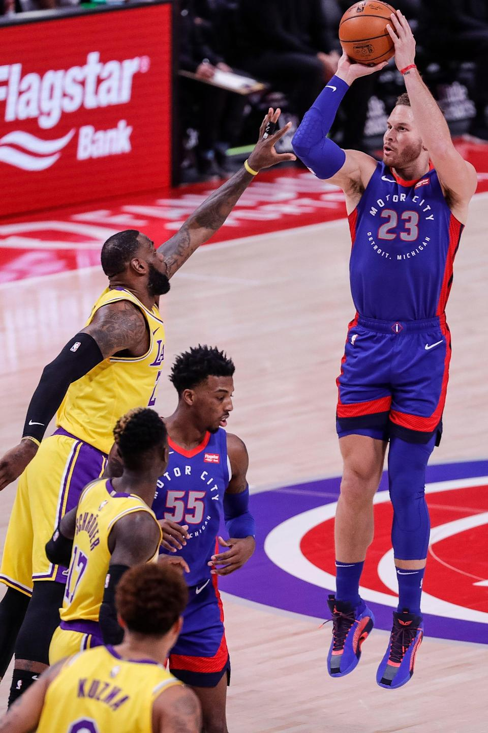 Detroit Pistons forward Blake Griffin (23) makes a jump shot against the Los Angeles Lakers forward LeBron James (23) during the first half of Thursday, January 28, 2021 at the Little Caesars Arena in Detroit.